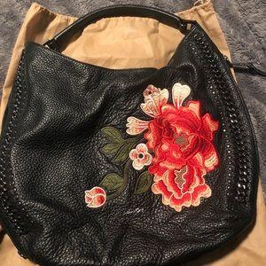Calvin Klein rose embroidered handbag